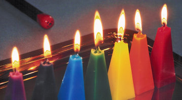 seven loose pyramid candles for birthday Buddha's